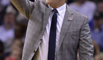 Atlanta Hawks head coach Mike Budenholzer calls to players in the first half of an NBA basketball game against the Memphis Grizzlies, Saturday, March 11, 2017, in Memphis, Tenn. (AP Photo/Brandon Dill)