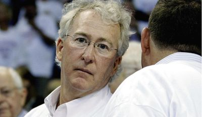 FILE - In this June 6, 2012, file photo, Chesapeake Energy Corp. CEO Aubrey McClendon attends Game 6 of the NBA basketball Western Conference finals in Oklahoma City.  Chesapeake Energy Corporation has withdrawn its claim for more than $455 million against the estate of  McClendon, clearing some of the claims against his estate. McClendon died in 2016 after he was indicted by a federal grand jury for allegedly conspiring to rig bids to buy oil and natural gas leases in northwest Oklahoma.  (AP Photo/Sue Ogrocki, File)