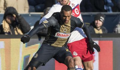Philadelphia Union's Jay Simpson, left, battles for the ball with Toronto FC's Eriq Zavaleta, right, during the first half of an MLS soccer match, Saturday, March 11, 2017, in Chester, Pa. (AP Photo/Chris Szagola)