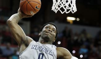 Nevada's Cameron Oliver dunks during the first half of an NCAA college basketball game against Fresno State in the Mountain West Conference tournament semifinals Friday, March 10, 2017, in Las Vegas. (AP Photo/Isaac Brekken)