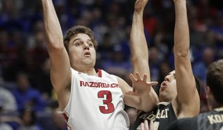 Arkansas guard Dusty Hannahs (3) shoots over Vanderbilt guard Nolan Cressler in the first half of an NCAA college basketball game in the semifinals of the Southeastern Conference tournament Saturday, March 11, 2017, in Nashville, Tenn. (AP Photo/Wade Payne)