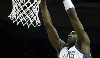 Milwaukee Bucks' Tony Snell dunks during the second half of an NBA basketball game against the Minnesota Timberwolves Saturday, March 11, 2017, in Milwaukee. (AP Photo/Aaron Gash)