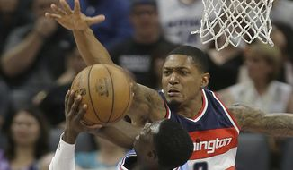 Washington Wizards guard Bradley Beal, right, tries to block the shot of Sacramento Kings guard Darren Collison during the first half of an NBA basketball game, Friday, March 10, 2017, in Sacramento, Calif. (AP Photo/Rich Pedroncelli)