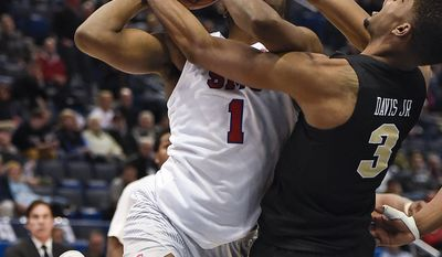 Central Florida's A.J. Davis, right, fouls SMU's Shake Milton, left, during the second half of an NCAA college basketball game in the American Athletic Conference tournament semifinals, Saturday, March 11, 2017, in Hartford, Conn. (AP Photo/Jessica Hill)