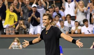Vasek Pospisil, of Canada, celebrates after defeating Andy Murray, of Great Britain, at the BNP Paribas Open tennis tournament, Saturday, March 11, 2017, in Indian Wells, Calif. Pospisil won the match 6-4, 7-6 (5). (AP Photo/Mark J. Terrill)