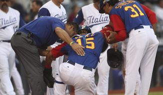 Venezuela's Salvador Perez is helped after being injured during World Baseball Classic game against Italy, in Guadalajara, Mexico, Saturday, March 11, 2017. All-Star catcher Perez injured his left knee in a home-plate collision with his Kansas City Royals backup Drew Butera in a World Baseball Classic game. Venezuela rallied to beat Italy 11-10 on Martin Prado's 10th-inning double after Butera stumbled into Perez to end the ninth with the score tied at 10.(AP Photo/Luis Gutierrez)