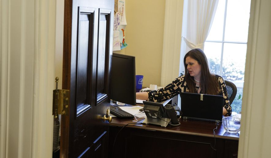In this March 8, 2017, photo, White House deputy press secretary Sarah Huckabee Sanders works in her office at the White House in Washington. The 34-year-old spokeswoman for President Donald Trump was schooled in hardscrabble politics _ and down-home rhetoric _ from a young age by her father, folksy former Arkansas Gov. Mike Huckabee. Her way with a zinger, and her unshakable loyalty to an often unpredictable boss, is a big reason why the deputy press secretary is a rising star in Trump's orbit.  (AP Photo/Evan Vucci)