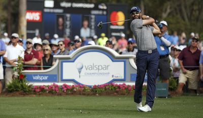 Adam Hadwin tees off on the 14th hole during the final round of the Valspar Championship golf tournament Sunday, March 12, 2017, at Innisbrook in Palm Harbor, Fla. (AP Photo/Mike Carlson)