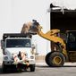 Road crews up and down the East Coast made preparations for a powerful nor'easter on Tuesday. (Associated Press)