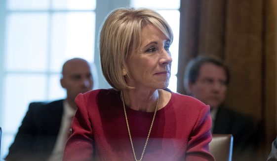 Education Secretary Betsy DeVos listens as President Donald Trump speaks during a Cabinet meeting in the Cabinet Room of the White House in Washington, Monday, March 13, 2017. (AP Photo/Andrew Harnik) ** FILE **