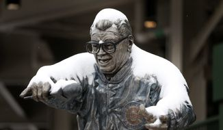 The statue of Chicago Cubs' broadcaster Harry Carey outside Wrigley Field has a coating of snow on it as the Chicago area gets it's first measurable snow since December, Monday, March 13, 2017, in Chicago. Much of the Midwest and beyond is getting snow as part of a storm that forecasters say will yield between 3 to 6 inches of snow.(AP Photo/Charles Rex Arbogast) **FILE**