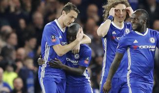 Chelsea players celebrate after Chelsea's N'Golo Kante, 2nd left, scored the opening goal during the English FA Cup quarterfinal soccer match between Chelsea and Manchester United at Stamford Bridge stadium in London, Monday, March 13, 2017. (AP Photo/Frank Augstein)