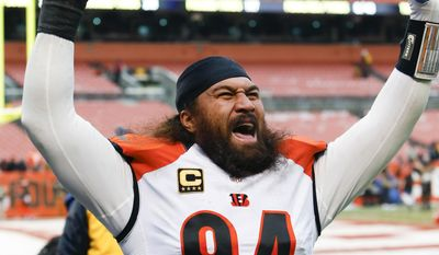 """In this Dec. 11, 2016, photo, Cincinnati Bengals defensive tackle Domata Peko (94) celebrates a 23-10 win over the Cleveland Browns in an NFL football game, in Cleveland. Peko was drawn to Denver by family and familiarity. Broncos coach Vance Joseph was on Marvin Lewis' staff in Cincinnati, where Peko spent his first 11 seasons """"and he and I had a really good relationship,"""" Peko said Monday, March 13, 2017, after signing his two-year, $7.5 million contract. In Denver, Peko also is reuniting with his cousin, Kyle Peko, a second-year nose tackle. (AP Photo/Ron Schwane)"""