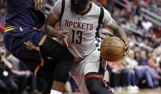 Houston Rockets' James Harden, right, drives toward the basket as Cleveland Cavaliers' Tristan Thompson defends during the second half of an NBA basketball game Sunday, March 12, 2017, in Houston. The Rockets won 117-112. (AP Photo/David J. Phillip)