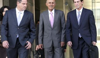 Former Los Angeles County Sheriff Lee Baca, center, leaves federal court in Los Angeles with attorneys David Hochman, left, and Nathan Hochman after his corruption trial went to the jury Monday, March 13, 2017, in Los Angeles. Prosecution and defense attorneys finished closing remarks earlier Monday. (AP Photo/Nick Ut)