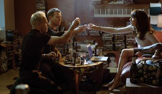 """This image released by TriStar Pictures shows, from left, Jonny Lee Miller, Ewan McGregor and Anjela Nedyalkova in a scene from """"T2: Trainspotting."""" (Jaap Buitendijk/Sony - TriStar Pictures via AP)"""