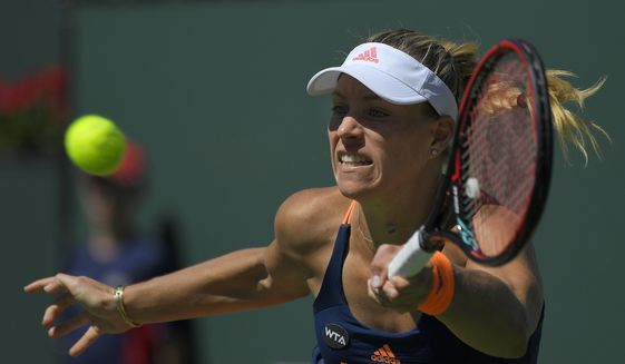 Angelique Kerber, of Germany, returns a shot to Pauline Parmentier, of France, at the BNP Paribas Open tennis tournament, Monday, March 13, 2017, in Indian Wells, Calif. (AP Photo/Mark J. Terrill)