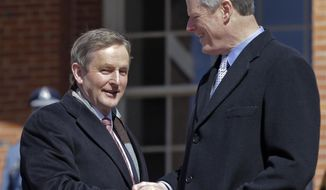 Massachusetts Governor Charlie Baker, right, shakes hands with Irish Taoiseach Enda Kenny as he arrives at the Massachusetts Statehouse, Monday, March 13, 2017, in Boston. (AP Photo/Elise Amendola)