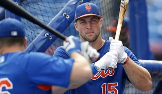 New York Mets' Tim Tebow (15) takes batting practice before a spring training baseball game against the Miami Marlins Monday, March 13, 2017, in Port St. Lucie, Fla. (AP Photo/John Bazemore)