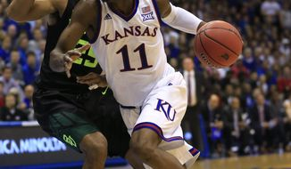 FILE - In this Feb. 1, 2017, file photo, Kansas guard Josh Jackson (11) drives against Baylor guard Al Freeman (25) during the first half of an NCAA college basketball game in Lawrence, Kan. Kansas coach Bill Self says star freshman Josh Jackson will play in the NCAA Tournament despite several off-the-court issues and allegations that Jackson and his representatives tried to bribe a student to make a vandalism accusation go away. (AP Photo/Orlin Wagner, File)