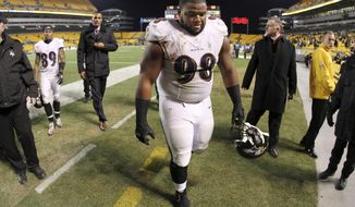 FILE - In this Nov. 3, 2014, file photo, Baltimore Ravens nose tackle Brandon Williams (98) walks off the field after a 43-23 loss to the Pittsburgh Steelers in an NFL football game. In assessing the NFL free agent market, Ravens general manager Ozzie Newsome weighed his options and decided 340-pound Brandon Williams was a keeper. (AP Photo/Gene J. Puskar, File)