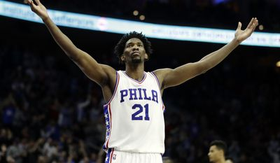 FILE - In this Jan. 27, 2017, file photo, Philadelphia 76ers' Joel Embiid reacts during an NBA basketball game against the Houston Rockets in Philadelphia. Embiid's numbers are the best in the rookie class. Yet his rookie of the year chances seem very flawed for this reason: Embiid will miss nearly two-thirds of Philadelphia's season because of injuries. (AP Photo/Matt Slocum, File)
