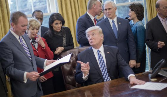 President Trump is working with Mick Mulvaney (left), director of the White House Office of Management and Budget, and other members of his team to prepare for a government shutdown in case Congress can't reach a budget deal by the end of the week. (Associated Press/File)