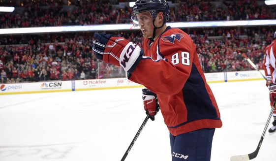 Washington Capitals defenseman Nate Schmidt (88) celebrates his goal as he skates to the bench during the first period of an NHL hockey game against the Minnesota Wild, Tuesday, March 14, 2017, in Washington. (AP Photo/Nick Wass)