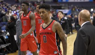 Rutgers' Nigel Johnson (0), Candido Sa (21) and Ibrahima Diallo (32) leave the court after an NCAA college basketball game in the Big Ten tournament against Northwestern, Thursday, March 9, 2017, in Washington. (AP Photo/Nick Wass)