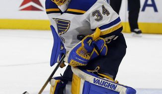St. Louis Blues goalie Jake Allen (34) stops the puck with his body during the second period of an NHL hockey game against the Los Angeles Kings in Los Angeles, Monday, March 13, 2017. (AP Photo/Alex Gallardo)