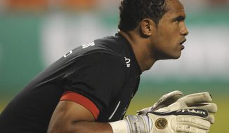 FILE - This April 7, 2010 file photo shows Flamengo's goalkeeper Bruno Fernandes de Souza during a soccer game in Rio de Janeiro, Brazil. Boa Esporte, a Brazilian soccer club, presented Souza on Tuesday, March 14, 2017, to announce his signing as goalkeeper. Souza was convicted in the killing of an ex-girlfriend, prompting outrage from many. He is free while appealing a 22-year prison sentence. (AP Photo/Felipe Dana, File)
