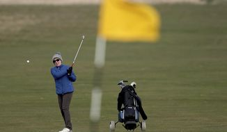 Woman golfer Jeanette Siehenthiler plays on the 18th hole after it was announced that women will be admitted as members of Muirfield Golf Club after a membership ballot was held by The Honourable Company of Edinburgh Golfers, in Gullane, Scotland Tuesday, March 14, 2017. Muirfield Golf Club voted Tuesday to admit female members for the first time in its 273-year history, paving the way for the Scottish golf club to again host the British Open.  ( Jane Barlow/PA via AP)
