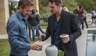 "This image released by Broad Green Pictures shows Ryan Gosling, left, and Michael Fassbender in a scene from, ""Song to Song."" (Van Redin/Broad Green Pictures via AP)"