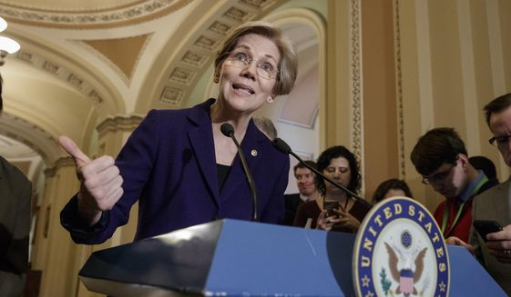Sen. Elizabeth Warren, D-Mass., speaks with reporters as Democrats criticize the Republican health care plan, at the Capitol in Washington, Tuesday, March, 14, 2017. The White House and Republican leaders in Congress are scrambling to shore up support for their health care bill after findings from the Congressional Budget Office estimated that 14 million people would lose insurance coverage in the first year alone under the GOP replacement for Obamacare. (AP Photo/J. Scott Applewhite)