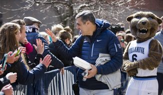 Villanova NCAA college basketball head coach Jay Wright talks to fans before boarding a bus as the team departs Villanova, Pa., on Monday, March 13, 2017, for a game in the first round of the NCAA Tournament, in Buffalo, N.Y. Teams chasing a college basketball title are contending with an unexpected wrinkle that's making last-minute travel plans even tougher: the anticipation of a storm bearing down on the Northeast that's expected to dump snow and wind. (AP Photo/Matt Rourke)