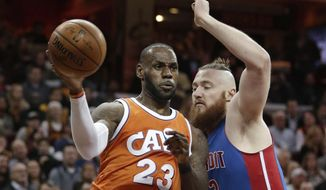 Cleveland Cavaliers' LeBron James (23) drives against Detroit Pistons' Aron Baynes (12), from New Zealand, in the first half of an NBA basketball game, Tuesday, March 14, 2017, in Cleveland. (AP Photo/Tony Dejak)