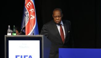 FILE - In this Thursday, Feb. 25, 2016 file photo, then Acting FIFA President Issa Hayatou enters the stage of a UEFA meeting in Zurich, Switzerland. Hayatou's reign could end at the Confederation of African Football's general assembly in Ethiopia on Thursday, March 16, 2017, after nearly 30 years as the head of the African soccer confederation and a top FIFA executive. (AP Photo/Michael Probst, File)