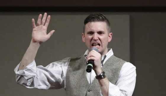 Richard Spencer, who leads a movement that mixes racism, white nationalism and populism, speaks at the Texas A&M University campus in College Station, Texas, in this Dec. 6, 2016, file photo. (AP Photo/David J. Phillip, File)