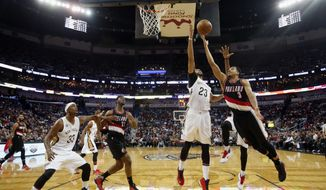 Portland Trail Blazers guard CJ McCollum (3) goes to the basket as New Orleans Pelicans forward Anthony Davis (23) moves in to block the shot in the first half of an NBA basketball game in New Orleans, Tuesday, March 14, 2017. (AP Photo/Gerald Herbert)