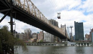 FILE - This May 1, 2014, file photo, shows the Roosevelt Island Tram crossing the East River to Roosevelt Island in New York. The island is getting its only hotel, the Graduate Roosevelt Island, in 2019. The boutique hotel will be located at the gateway to the new Cornell Tech campus. (AP Photo/Beth J. Harpaz, File)