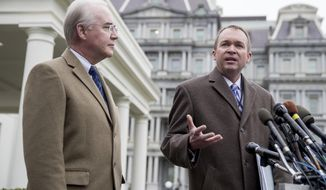 Budget Director Mick Mulvaney, right, accompanied by Health and Human Services Secretary Tom Price, left, speak outside the West Wing of the White House in Washington, Monday, March 13, 2017, after Congress' nonpartisan budget analysts reported that 14 million people would lose coverage next year under the House bill dismantling former President Barack Obama's health care law. (AP Photo/Andrew Harnik)