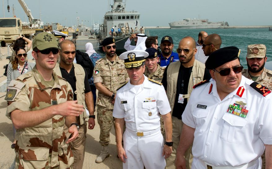 Vice Adm. Kevin Donegan, commander of U.S. Naval Forces Central Command (middle) warned that Iranian-backed Houthi rebels have employed an Iranian-designed remotely piloted small boat filled with explosives to take out enemy targets. He also said Iran supplied the explosives. (U.S. Navy)