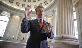 "Sen. Rand Paul, R-Ky., a vociferous opponent of the House Republican healthcare reform plan, referring to it as ""Obamacare light,"" discusses the bill before a TV interview on Capitol Hill in Washington, Wednesday, March 15, 2017. (AP Photo/J. Scott Applewhite)"