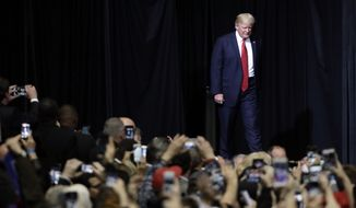 President Donald Trump walks to the stage to speak at a rally Wednesday, March 15, 2017, in Nashville, Tenn. (AP Photo/Mark Humphrey)