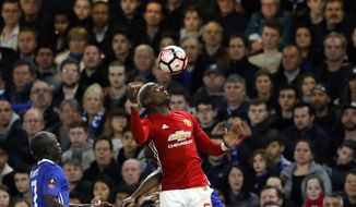 United's Paul Pogba controls the ball during the English FA Cup quarterfinal soccer match between Chelsea and Manchester United at Stamford Bridge stadium in London, Monday, March 13, 2017. (AP Photo/Frank Augstein)