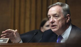 """Come on Uncle Sam, where's the money?"" Sen. Richard J. Durbin, Illinois Democrat, said in a hearing called to look at gangs' prevalence among illegal immigrants. (Associated Press/File)"
