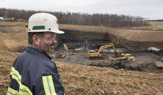 ADVANCE FOR SATURDAY MARCH 18 AND THEREAFTER - In a Tuesday, Feb. 28, 2017 photo, Rob Bottegal, head engineer of the Acosta Deep Mine for Corsa Mining, looks at an overview of the mine while explaining the layout, at the Acosta Deep Mine, in Jenner Township, Pa. The Canonsburg-based company is on schedule to open its Acosta Deep Mine in May, with a plan for at least 70 miners to remove about three miles of metallurgical-quality coal over the next decade.  (Dan Speicher/Pittsburgh Tribune-Review via AP)