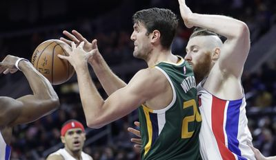 Utah Jazz center Jeff Withey has the ball knocked out of his control as Detroit Pistons' Aron Baynes defends during the first half of an NBA basketball game Wednesday, March 15, 2017, in Auburn Hills, Mich. (AP Photo/Carlos Osorio)