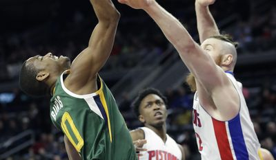 Utah Jazz guard Alec Burks (10) loses control of the ball defended by Detroit Pistons center Aron Baynes during the first half of an NBA basketball game, Wednesday, March 15, 2017, in Auburn Hills, Mich. (AP Photo/Carlos Osorio)