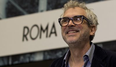 "Mexican director Alfonso Cuaron leaves a press conference following the end of filming of his new movie ""Roma,"" in Mexico City, Tuesday, March 14, 2017. ""Roma,"" a family drama set in the 1970s, marks the first time the Oscar-winning director has filmed in his home country since 2001's ""Y tu mama tambien."" (AP Photo/Rebecca Blackwell)"